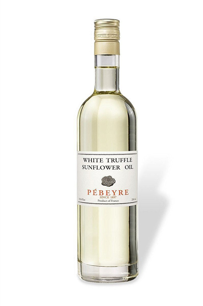 Made with Sunflower seed oil and white truffles, this White truffle oil is never cooked and is light in flavor. The oil is delicious with eggs, pasta with cheese, risottos, and dishes where it will be added after the cooking is completed. Whether you want to drizzle this truffle oil over tomatoes, or finish off your favorite pasta with it, it will never let you down!