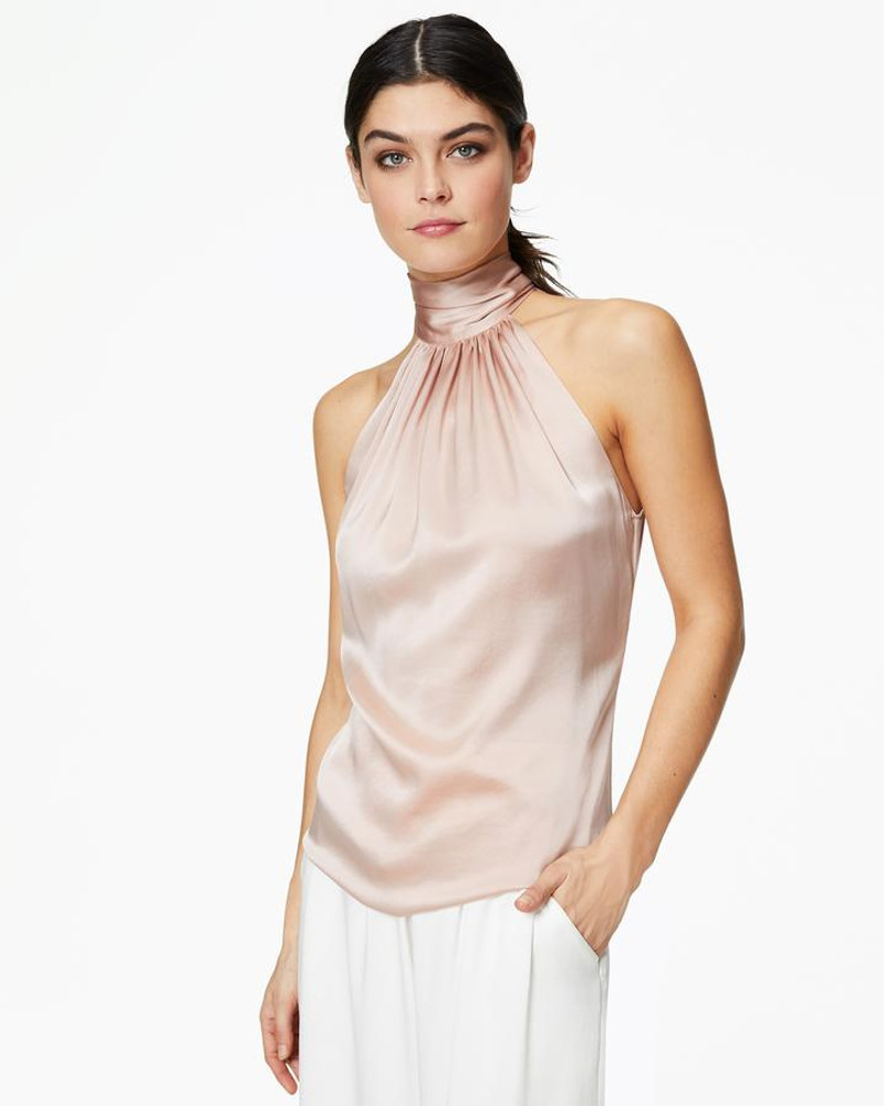Blush  Stunning, no matter how you wear it. Ramy Brook's ultra versatile Lori top features a dramatic high neckline that makes it glamorous enough for parties, but easy enough to wear everyday.   This style runs on the larger side, so we suggest sizing down.