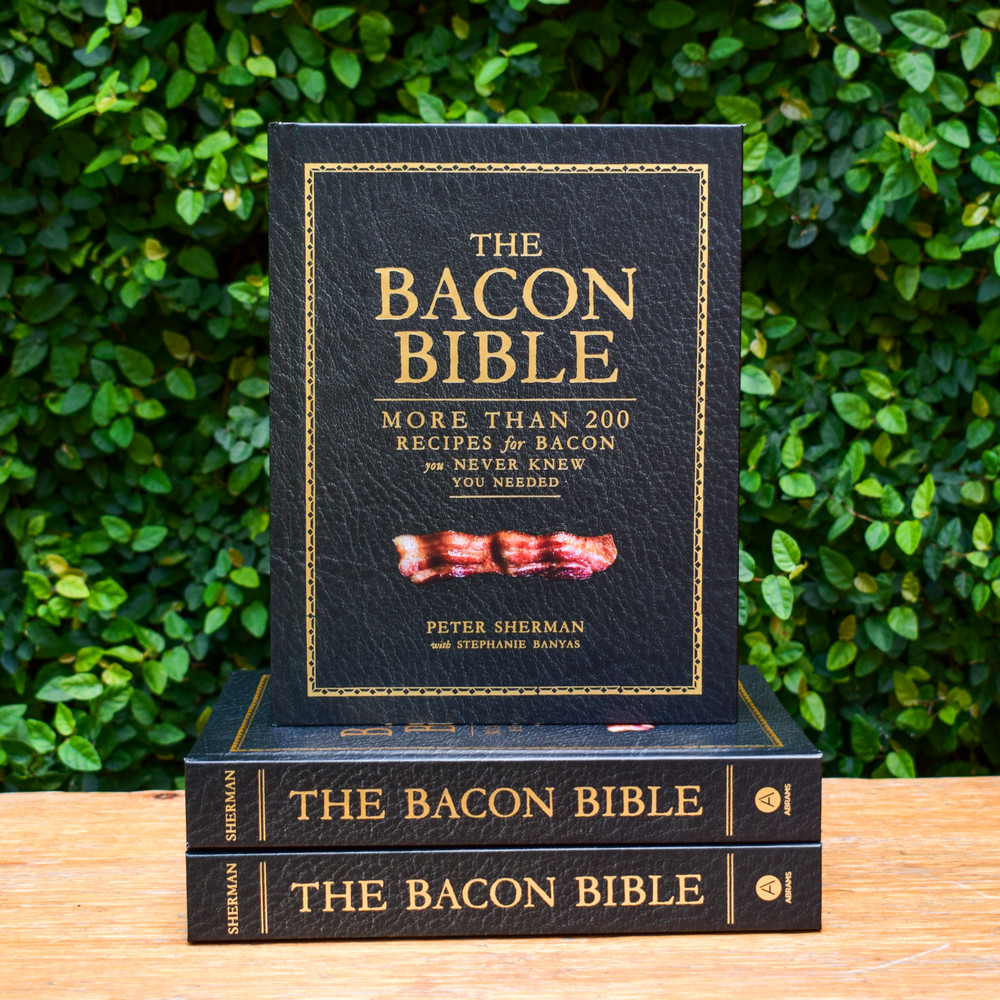 Bacon is Peter Sherman's North Star. In 2014, he opened BarBacon, a bacon-themed gastropub in New York City, to immediate critical and financial success, and he has become the go-to bacon guru for the world. Sherman has a nearly religious devotion to bacon, and in his tome, The Bacon Bible, he shares more than 200 recipes that show you how to incorporate bacon into nearly any meal you can imagine.  There are the classics, like BLTs, wedge salads, and mac and cheese, but the book really encourages you to cook with bacon in unexpected ways with recipes like Bacon Ramen, Chipotle Bacon Tacos, and Bacon Bourbon Oatmeal Pancakes. Peter also teaches you the basics, like how to cure simple bacon from scratch. He has a mad-scientist approach to bacon and is a firm believer that it should be a part of every meal. With this cookbook, you'll never think of bacon the same way.