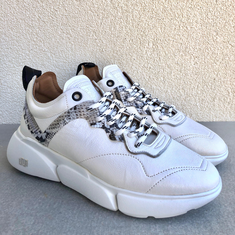 Fashion and comfort collide to bring you the Chunky Sneaker. Great to throw on with your work out clothes, or dress up with denim, the snakeskin detail adds just enough pop to any outfit!