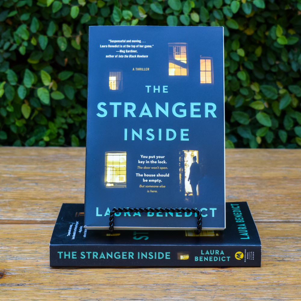 """A woman returns home to find a stranger living in her house in this """"suspenseful and moving"""" psychological drama from an Edgar Award-nominated author (Meg Gardiner) -- perfect for readers of Shari Lapena and Liane Moriarty. There's a stranger living in Kimber Hannon's house. He tells the police that he has every right to be there, and he has the paperwork to prove it. But Kimber definitely didn't invite this man to move in. He tells her that he knows something about her, and he wants everyone else to know it, too. """"I was there. I saw what you did."""" These words reveal a connection to Kimber's distant past, and dark secrets she'd long ago left buried. This trespasser isn't after anything as simple as her money or her charming Craftsman bungalow. He wants to move into her carefully orchestrated life -- and destroy it."""