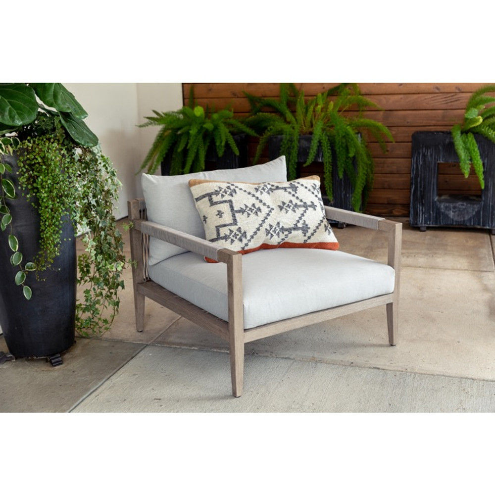 Summer is on its way, and there's no reason your outdoor space shouldn't be as stylish as your indoor. The modern silhouette of the Williams chair is formed by a washed brown teak frame, removable water repellant, UV resistant and sun-proof cushions and finished off with rope detail along the back and arms to add an additional layer of texture.