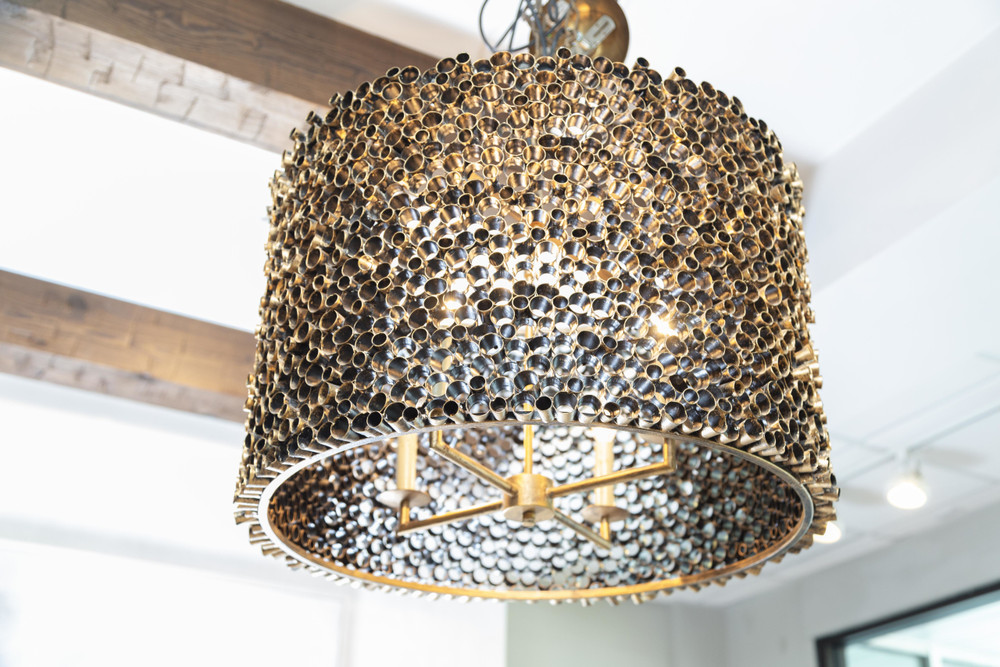 The Port Merion Chandelier is made up of cut round pipe in varying lengths giving it a unique texture and warm glow. The hand finishing truly makes each one of these chandeliers a one of a kind.