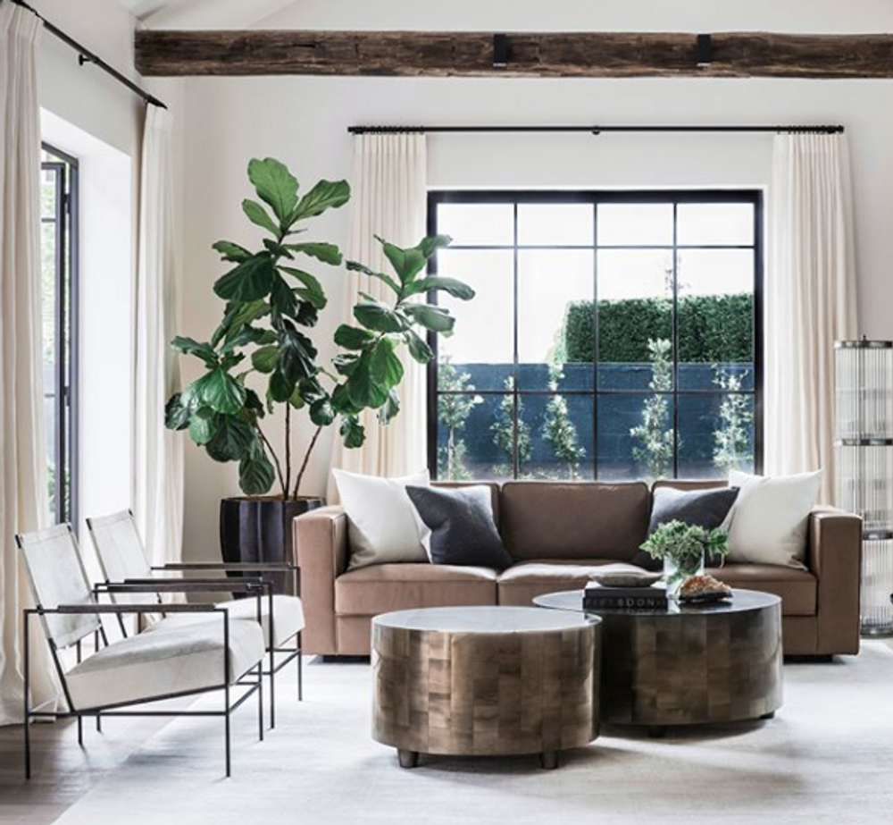The Anders Chair is the perfect combination of industrial, rustic, and high design. The Iron frame is accented with charcoal finished wood arms and a light hide seat and sling back. The generous proportions give it a light and modern feel while creating a comfortable seat for any room in the house.