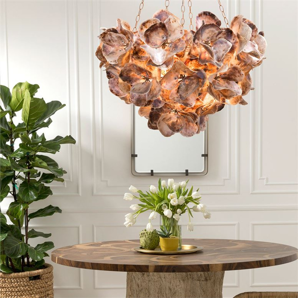 This chandelier is a true work of art, the natural saddle oyster shells are hand placed creating a unique and natural feel.