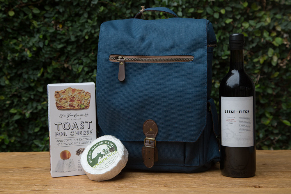 Ready for an outdoor concert, an afternoon in the park, or a bike ride to the lake? The Moreno Wine Tote is the perfect thing to bring along! It securely carries three full size wine bottles, room for your cheese and crackers and conveniently stores a cheese board, knife, and wine opener.