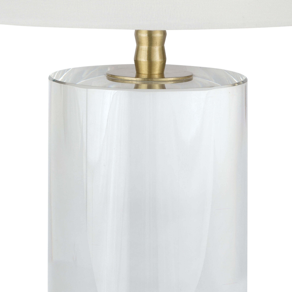 This solid crystal cylinder lamp base features a sleek silhouette and uniquely designed natural brass neck. The understated yet glamorous Johanna, fits in with almost all styles of decor, be it traditional, transitional, modern and even coastal.