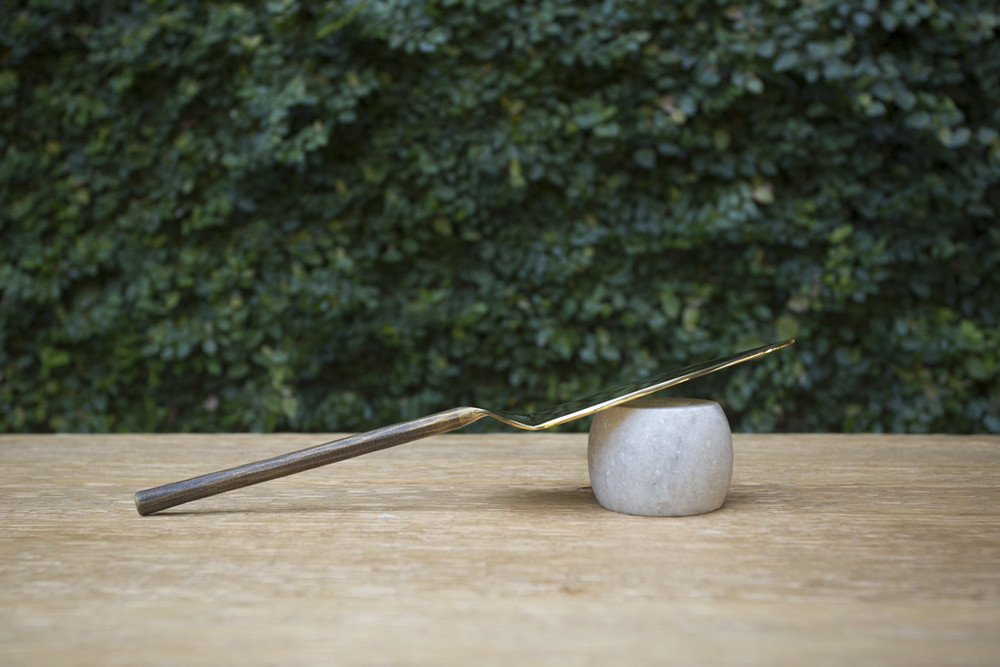 Formed from solid brass with polished heads and svelte, blackened handles.
