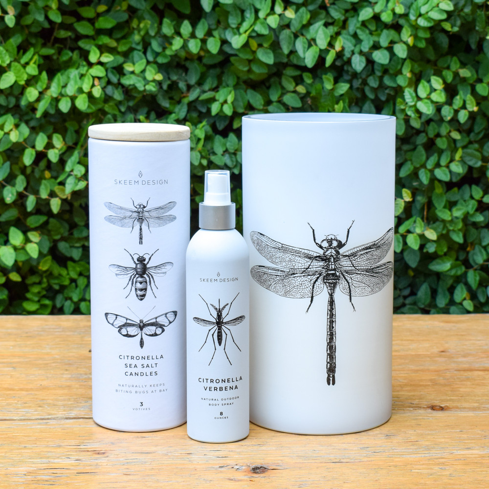 "Ready to enjoy your outdoor space but can't handle the insect? We've got your answer! This Citronella Sea Salt Hurricane is as handsome as it is helpful at keeping the bugs away. The Citronella blends nicely with the fragrance of ocean air and hints of jasmine creating a peaceful and helpful fragrance.   Hand poured in the USA with Skeem Design's exclusive soy base.  - 160 hour burn time   - 10""h X 5""w   - wax is 4"" below rim for wind protection   - triple wick"