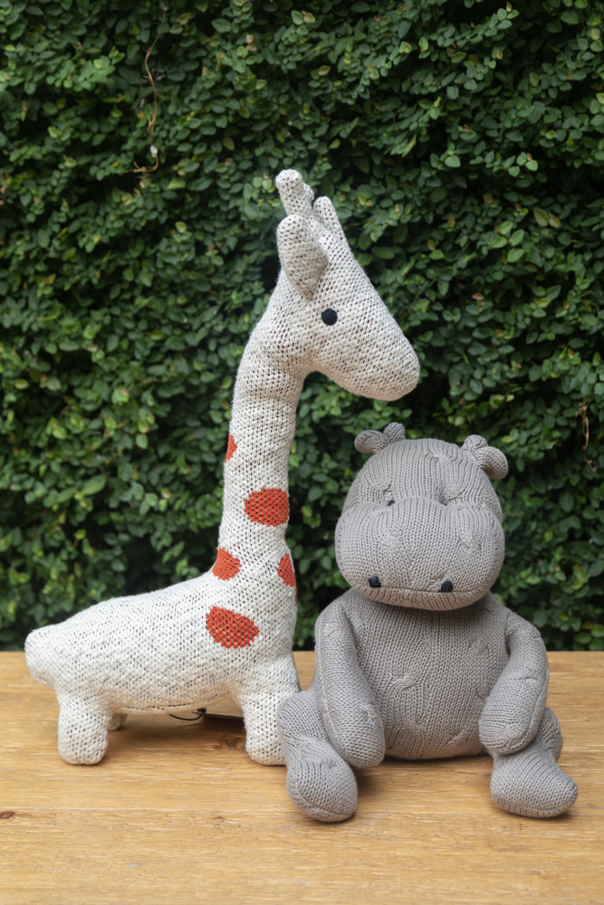 This super cuddly giraffe is sure to brighten the mood. Made of soft cotton, its the perfect gift for animal lovers of all ages!