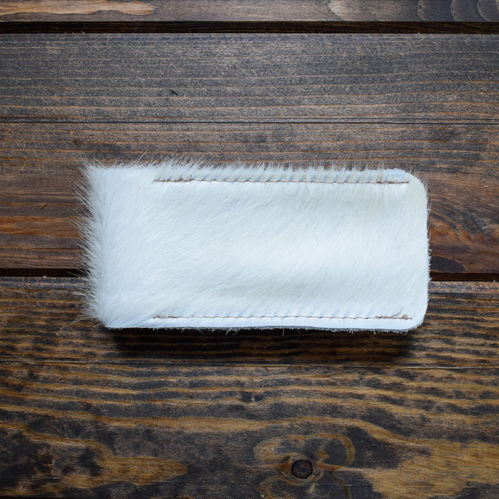 Hair on Hide These sunglass cases are the perfect pick me up or gift! Made of 100% Leather or Hair on Hide they fit most sunglasses easily.