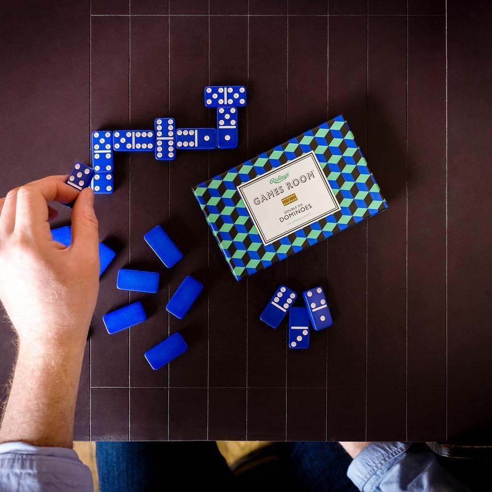 Some classics never go out of style! Update your dominoes with this bold blue set.