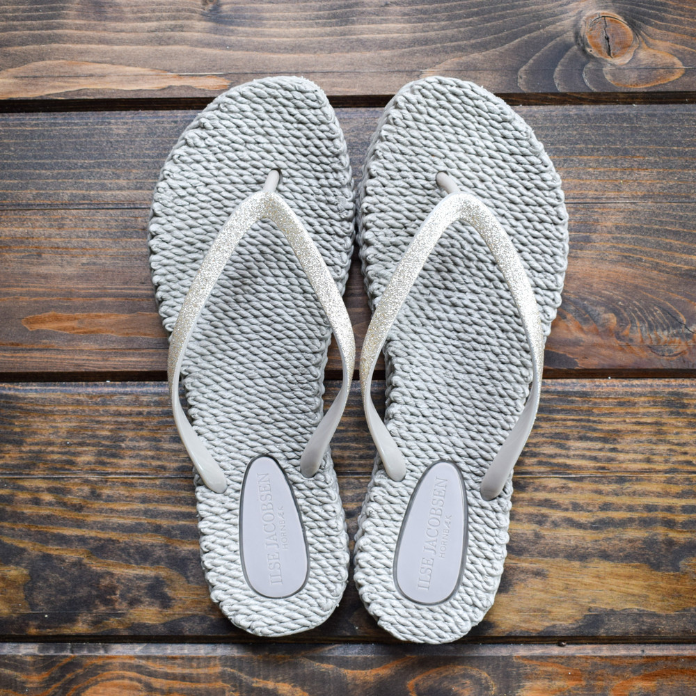 Who said you flip flops have to be boring? These will add a little sparkle to all your flip flop activities, whether it be pedicures, beach days, pool visits, or campground showers! The rubber weave bottom ensures you have maximum grip, even when your feet are wet and the texture gives the sensation of a soft massage as you walk. These flip flops run true to size but are sold in whole sizes only, if you are a half size we recommend you size up to the next whole size.