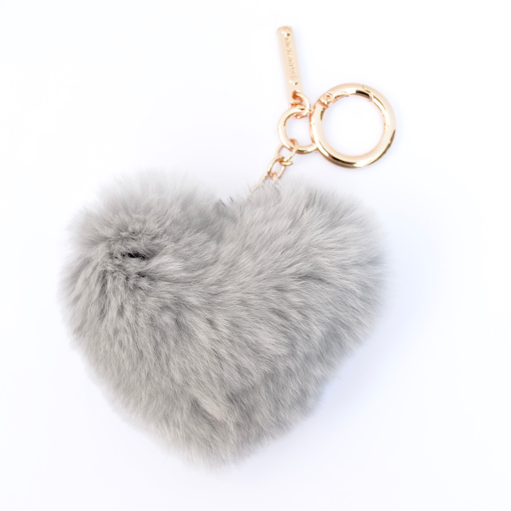 Adorable, soft, and a pop of color all ingredients for the perfect keychain. These rex rabbit heart keychains look great attached to your keys, on the side of your purse, or even on a backpack. The super soft fur also makes it easy to find your keys when they've fallen into the abyss of your purse! Available in multiple colors.     Please specify preferred color in order notes.