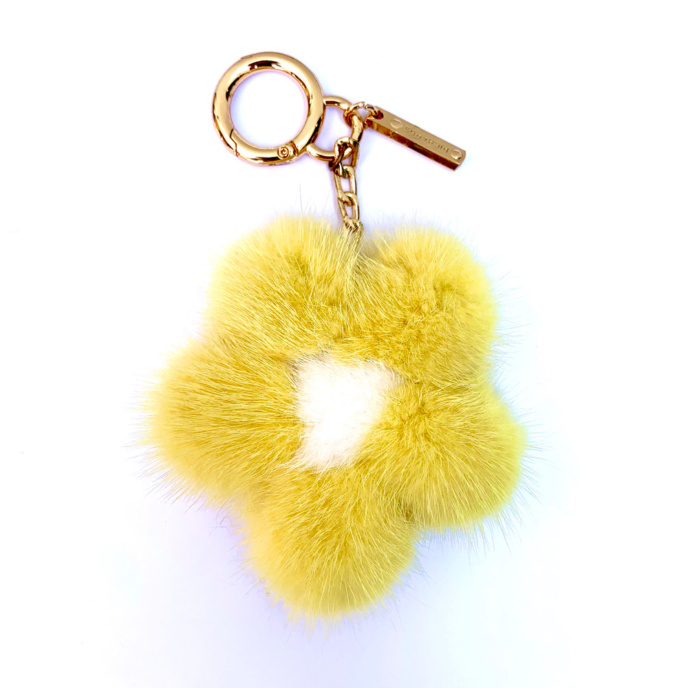 Add a little luxe to your everyday. These mink flower keychains look great attached to your keys, on the side of your purse, or even on a backpack. The soft fur also makes it easy to find your keys when they've fallen into the abyss of your purse! Available in multiple colors.   Please specify preferred color in order notes.