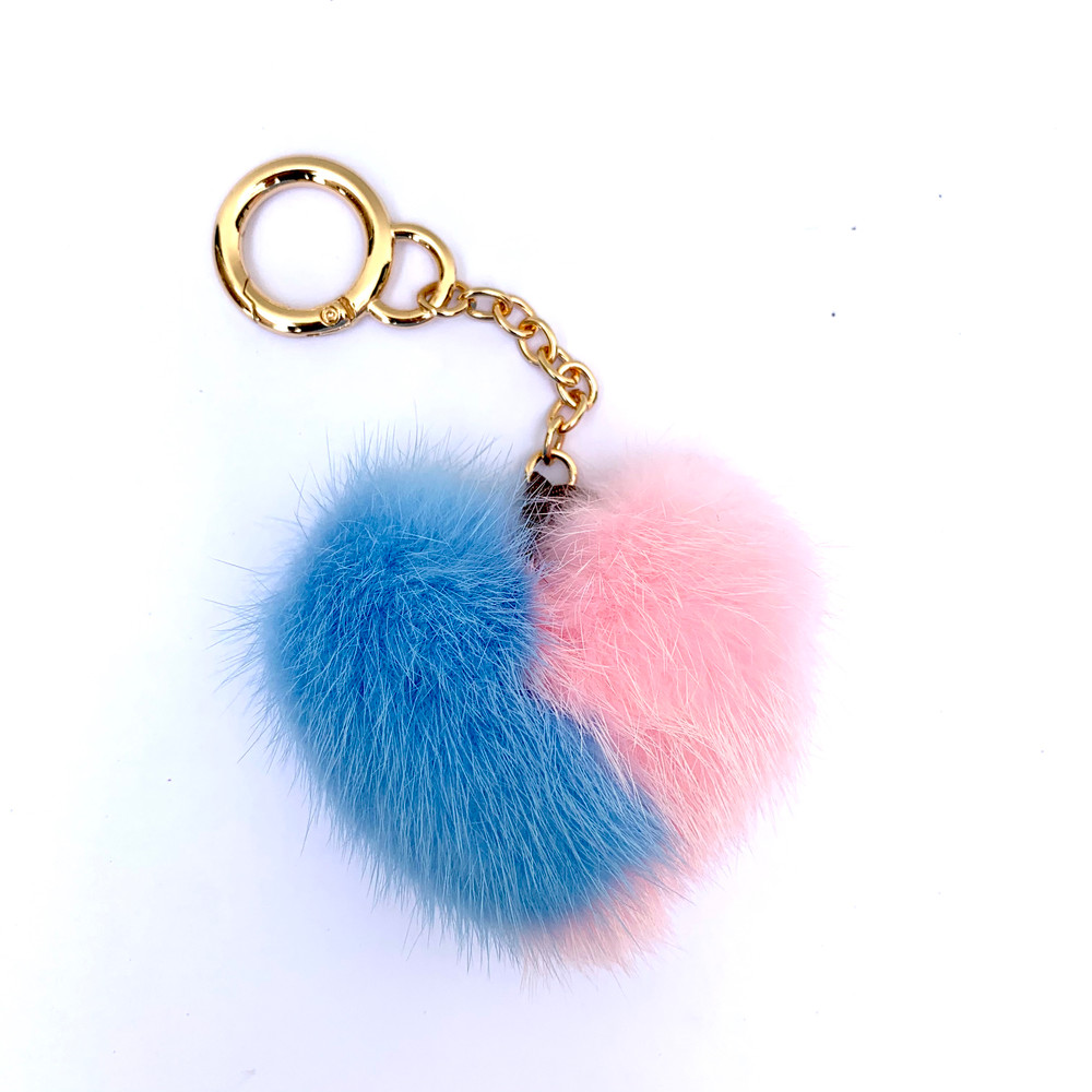 Add a little luxe to your everyday. These mink heart keychains look great attached to your keys, on the side of your purse, or even on a backpack. The soft fur also makes it easy to find your keys when they've fallen into the abyss of your purse! Available in multiple colors.   Please specify preferred color in order notes.
