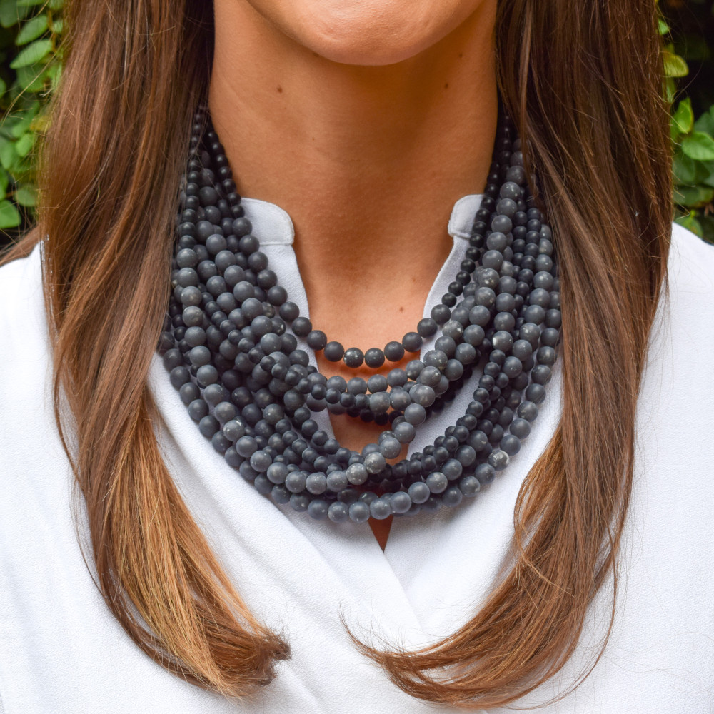 The Adriana necklace is handmade in Italy  featuring 8mm and 6mm marble matte beads and a magnetic closure on the leather collar. This piece easily transforms an outfit and pairs nicely with anything from a cotton tee to a silk blouse!