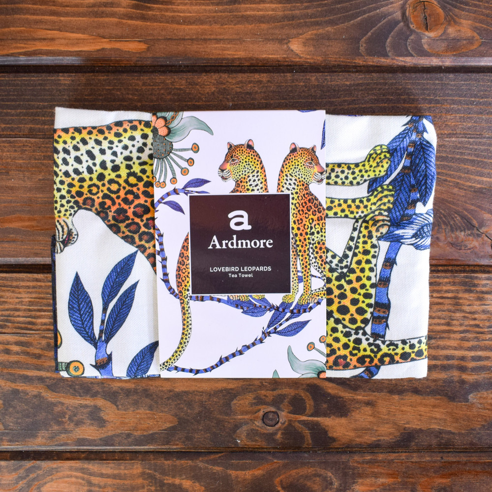 """Lovebird Leopards  Made in South Africa, the Ardmore artist perfectly capture the spirit of the country. The vibrant colors and animated animals bring something lively and inspiring into your home.     - 19.5"""" X 27.5""""   - 100% Cotton   - Made in South Africa"""