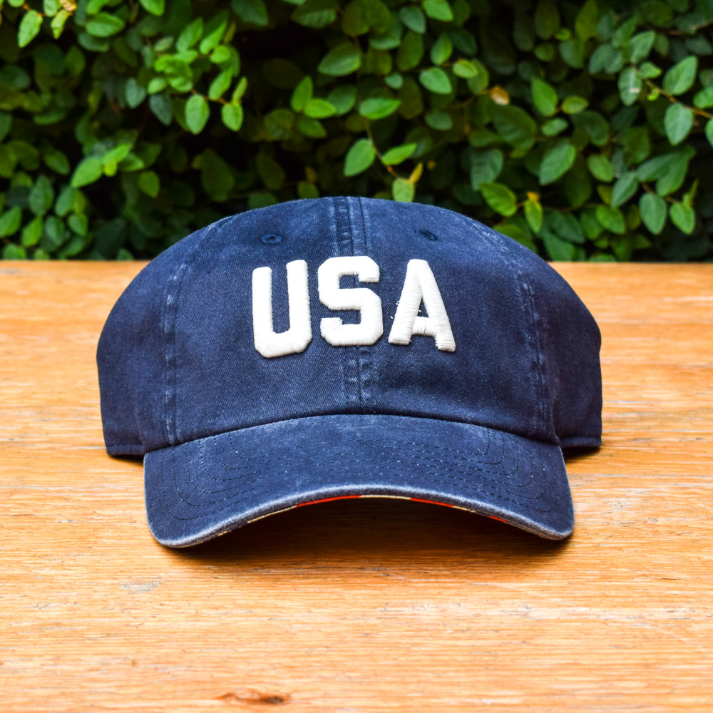 Wether it's a bad hair day or a day in the sun this isaA classic ball cap you'll never want to take off! These American Needle  hats consist of a pigment washed cotton twill with a soft structured crown and adjustable self-fabric backstrap.