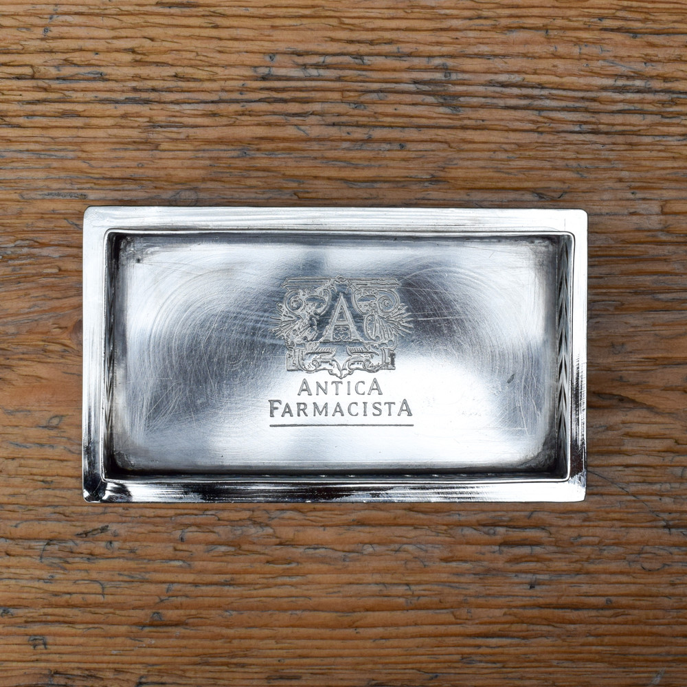 """The finishing touch for any room in your home. The nickel-plated tray accompanies Antica Farmacista's bath and body products perfectly to complete the polished look.   Made to hold two 10oz Antica Farmacista products.   5.25""""w X 1.25""""t X 3""""d"""
