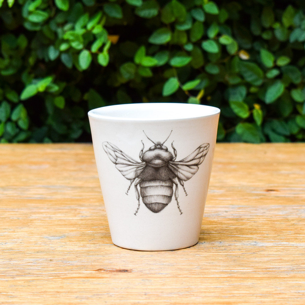 The perfect little. cup for every little thing. Fill it with your favorite beverage while dining, use it as a bathroom glass or as pot for your favorite little plant. This cup is sure to make you happy wherever it lives.   3.5"