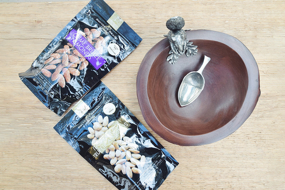 This uniquely whimsical piece is accessorized with a pure pewter acorn scoop.