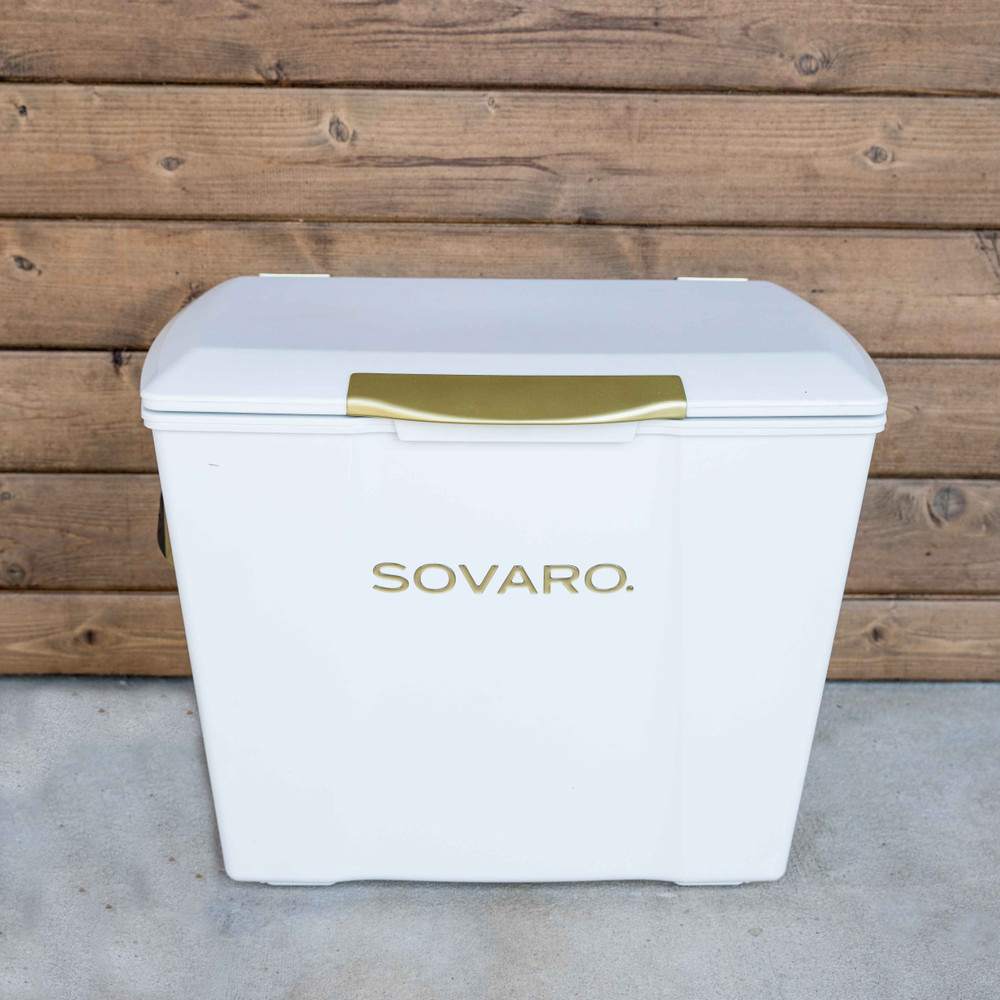 """Stylish, functional, and on wheels! What more could you need in a cooler? Sovaro has checked all the boxes and more with their hard-sided coolers.   THE DETAILS - Modern, clean lines give this cooler an elevated simple style while offering uncompromised performance.   - The exterior height is sized to provide comfortable seating, while the extra height inside gives you room to store wine or spirit bottles upright.   - Cast side handles for easy lifting, telescoping extension handle for easy pulling, and heavy-duty wheels for easy rolling.    - Friction hinges make for easy close and an open hold while the one-touch latch ensure a tight seal.  - The transparent interior liner is scratch resistant, easy to clean and the reservoir holds extra liquids while the rear plug allows for easy drainage.   - The cork is not just a pretty feature, it is a natural insulator, impermeable to gas and liquid and doesn't attract mold or mildew.   - Each cooler includes a removable divider for easy organization.     30 qt cooler  - Capacity: 8 standing wine bottles   - 16 5/8""""l X 23 1/9""""w X 17 3/4""""h   45 qt cooler  - Capacity: 10 standing wine bottles"""