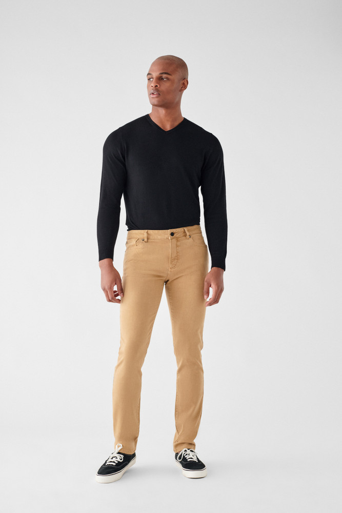 Dijon   DL1961 is known for their comfort and supreme quality. The Nick Slim Jean is no different, made of only the highest quality fabrics these will be your favorite jeans you'll never want to take off. A true slim fit with a leg that is lean through the thigh and tapered toward the ankle.