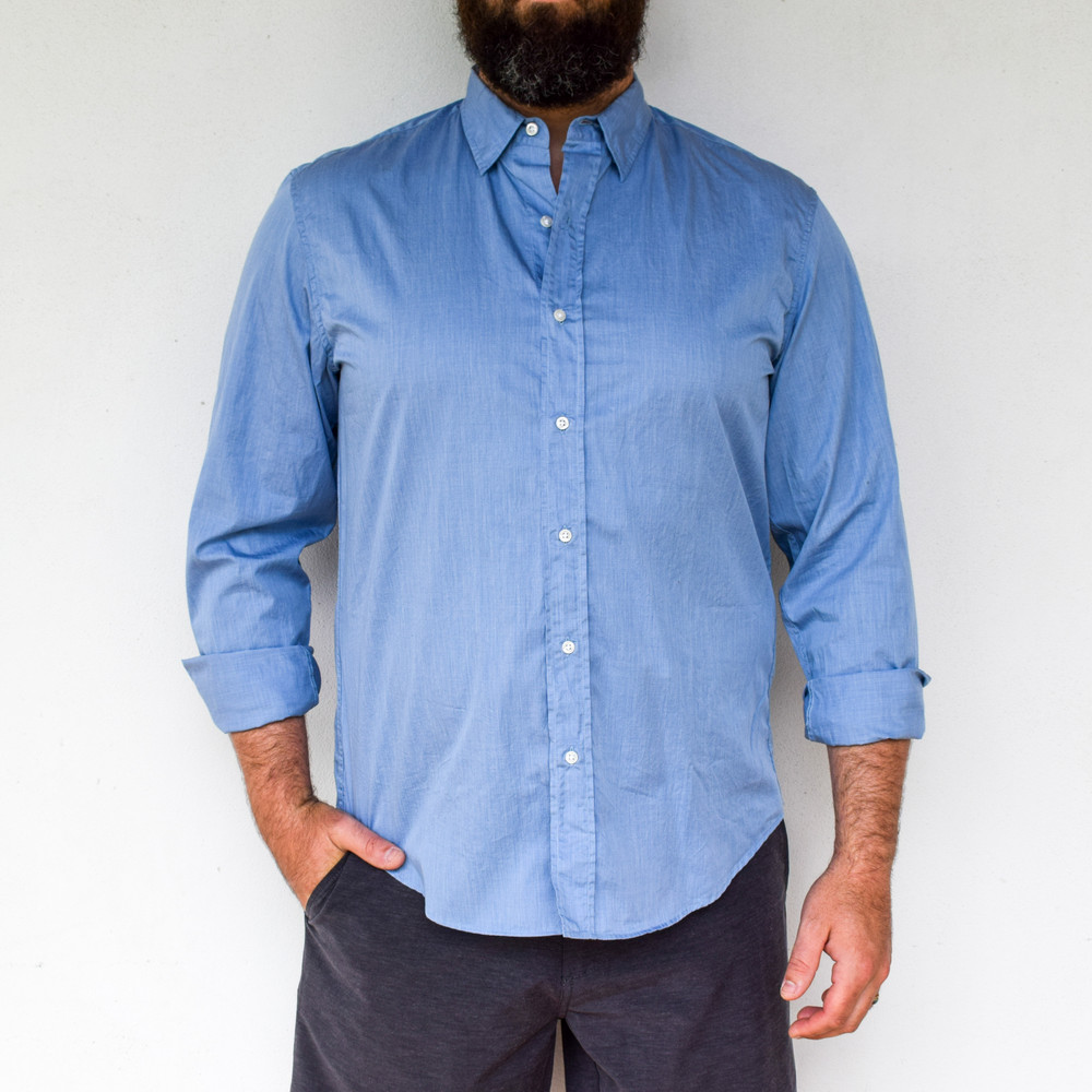 Heather Blue   A classic styled button down. Finbar has no front pockets and a hidden button down collar, perfect for dressing up with a suit, or wearing untucked for a tailored casual look. Made from the finest fabrics, you will be looking fresh where ever you end up!