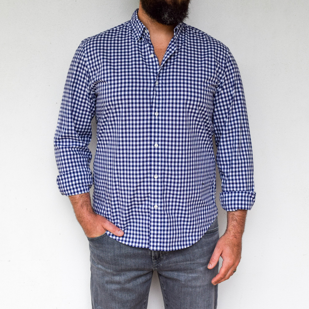 Navy Check   A classic styled button down. Finbar has no front pockets and a hidden button down collar, perfect for dressing up with a suit, or wearing untucked for a tailored casual look. Made from the finest fabrics, you will be looking fresh where ever you end up!