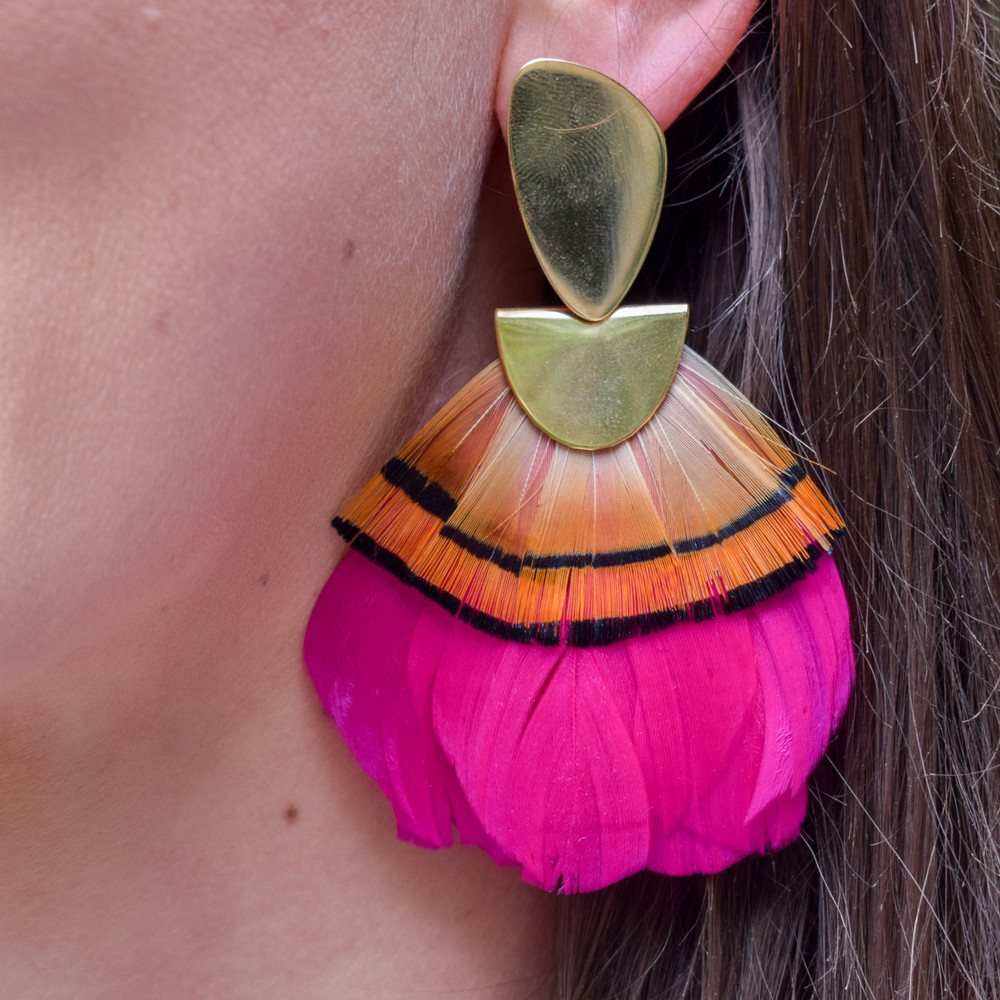 Fuschia & Gold Pheasant   A statement earring that is as light as a feather! These Federika Padula earrings are made with natural and dyed feathers to give a bold statement earring. The post earring sit comfortably in the lobe while the feather give a bold statement look and doesn't weigh down on the pierce hole.