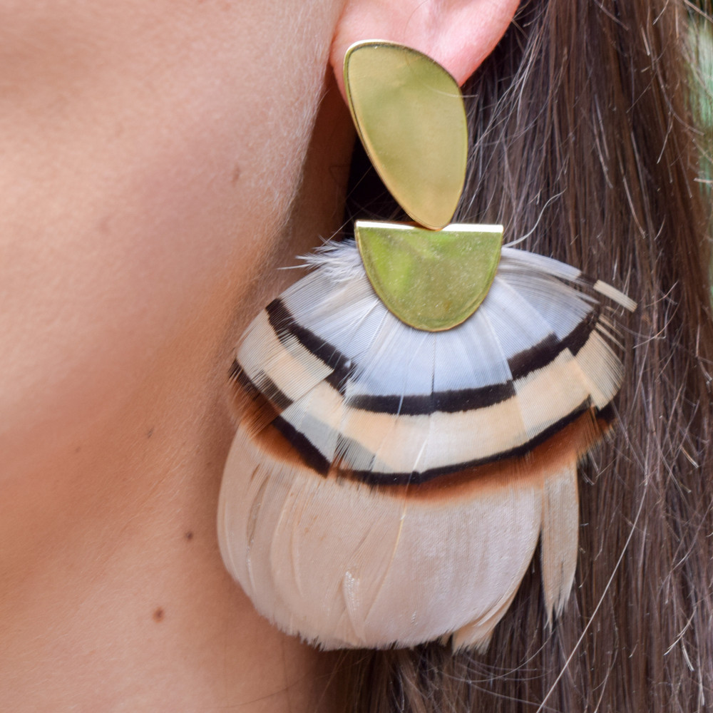 Latte & Natural Lady Amherst   A statement earring that is as light as a feather! These Federika Padula earrings are made with natural and dyed feathers to give a bold statement earring. The post earring sit comfortably in the lobe while the feather give a bold statement look and doesn't weigh down on the pierce hole.