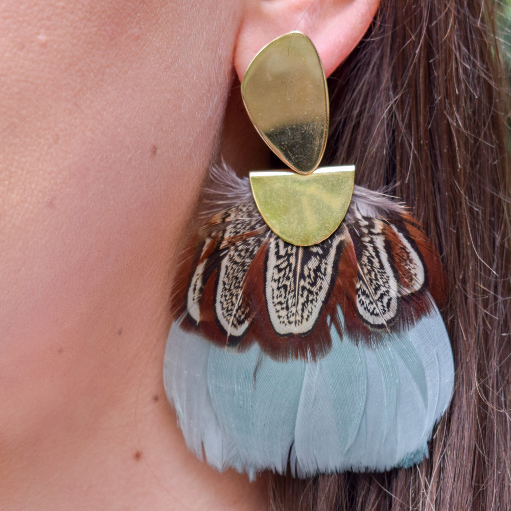 Montpellier   A statement earring that is as light as a feather! These Federika Padula earrings are made with natural and dyed feathers to give a bold statement earring. The post earring sit comfortably in the lobe while the feather give a bold statement look and doesn't weigh down on the pierce hole.