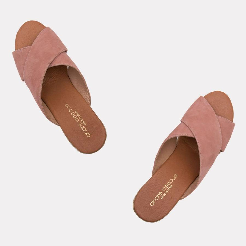 "Your summer throw on shoe, whether you're headed to the pool, beach, or grocery the Amber can take you there in style! The ultra cushy foot bed will make sure you can go all day, the neutral blush suede will compliment all of your favorite sundresses and the 1"" toe platform gives you just a little bit of height."