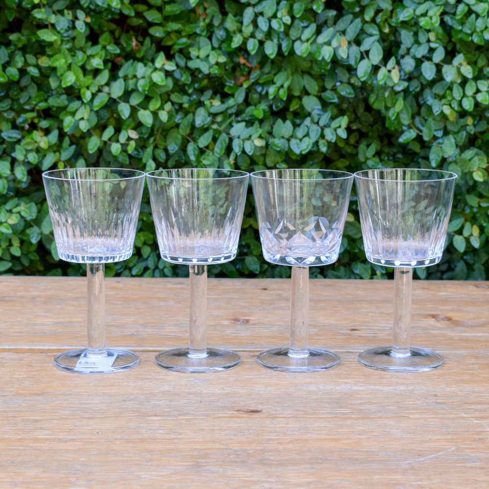 An assorted set of four wine goblets that are perfect for you favorite wine, as a desert coup, or as a spirits glass. The hand-cut glass is reminiscent of Polish wood carvings with their patterned angles. A great gift for yourself or others!