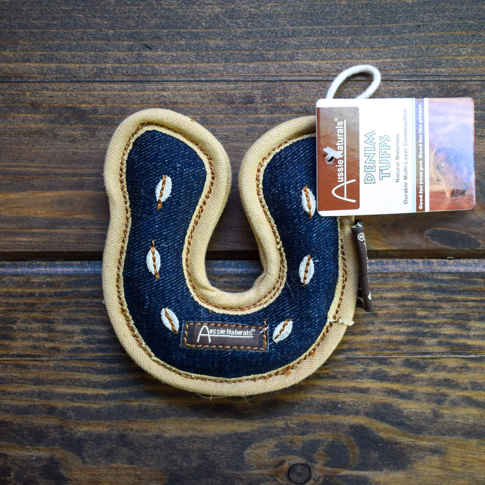 Made for the hardest of chewers these denim tuff horse shoes are made with natural denim material and filled with a coconut fiber. Reinforced binding gives it the extra strength to live through hours of tug-a-war, fetch, and puppy teeth.