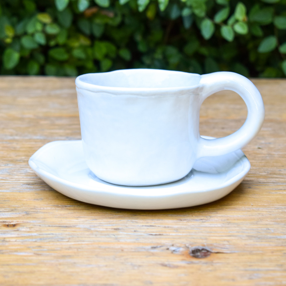 Tea for two? This is the perfect cup and saucer! Handmade with an organic feel and a classic white ceramic glaze to elevate your tea time.