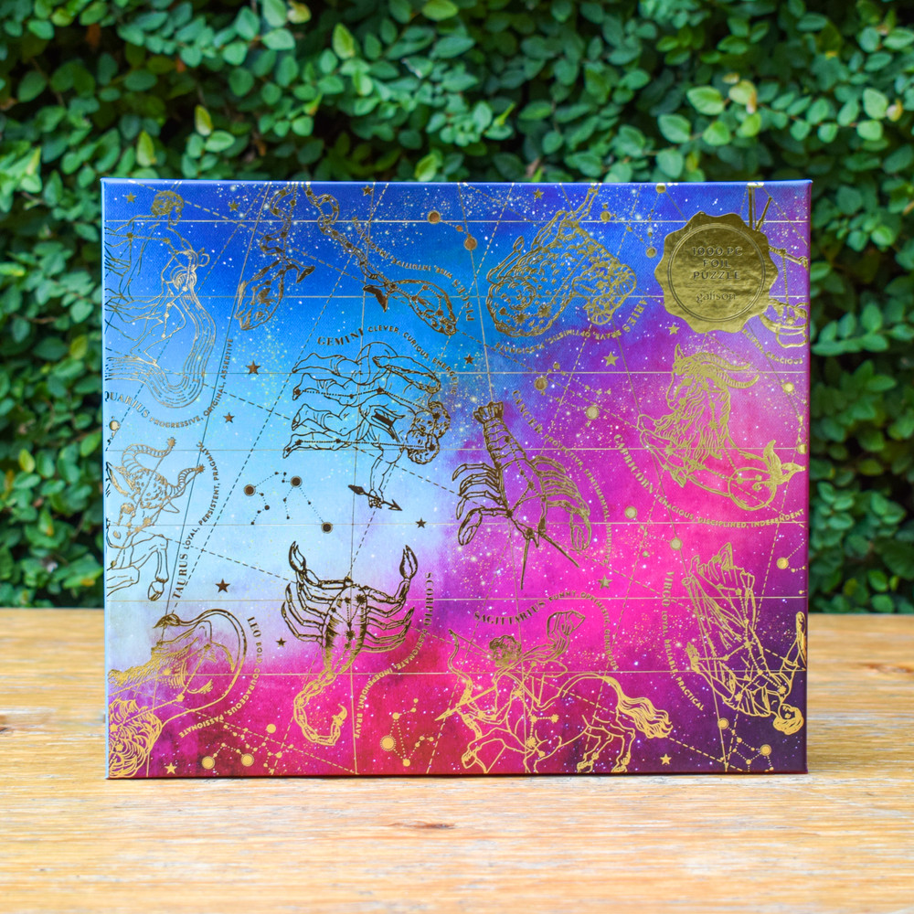 The twelve signs of the zodiac take on cosmic sparkle and shimmer on this gold foil embellished puzzle. Puzzle insert includes fun astrological facts.