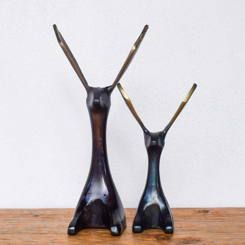 A modern and whimsical take on a rabbit, these fun sculptures are the perfect accessory for any bookcase or shelf. The bronze finish adds a nice warmth to the sleek lines.