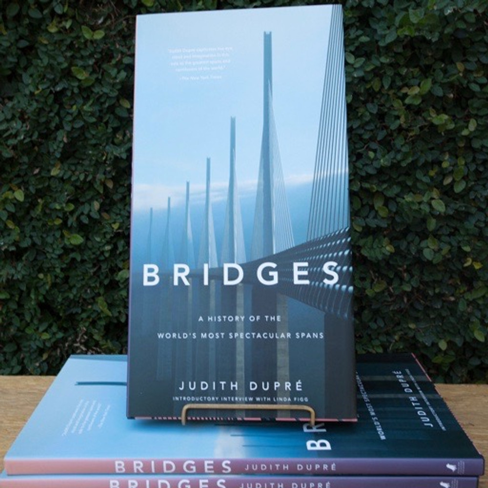 From the best-selling author of Skyscrapers comes the much-anticipated twentieth-anniversary edition of her magnificent chronological tour of the world's most significant and eye-popping spans, now in color and bigger than ever.  This visual history of the world''s landmark bridges is updated and expanded since its initial publication twenty years ago, with all-new photographs and features on cutting edge work by international superstars of architecture and engineering. Spanning two-thousand years of technological and aesthetic triumphs, Bridges stands as the most thorough, authoritative, and gorgeous book on the subject. With its dynamic design and oversized format, the book is as dramatic as the structures it celebrates. Breathtaking photographs capture the bridges' details as well as their monumental scale; location maps and architectural drawings invite you behind the scenes as new bridges take shape; and lively commentary on each explores its historical context and significance. Throughout, informative profiles, sidebars, and statistics make BRIDGES an invaluable reference as well as a visual feast. Technological advances, structural daring, and artistic vision have propelled the evolution of bridge designs around the world. The last thirty years has seen the construction of masterpieces such as the Zakim Bridge that changed the city of Boston; Gateshead Millennium Bridge in England, a pedestrian tilt bridge that closes like an eye when it is raised; the Millau Viaduct in Tarn Valley, France, now the tallest cable-stay bridge in world; and the 102-mile Danyang-Kunshan Grand Bridge in China, the longest in the world. This all-new twentieth-anniversary edition features profiles on these amazing spans and on beloved landmarks, such as the Golden Gate and the Brooklyn Bridge, as well as thematic chapters on lighting technologies, military bridges, and bridges in the movies.