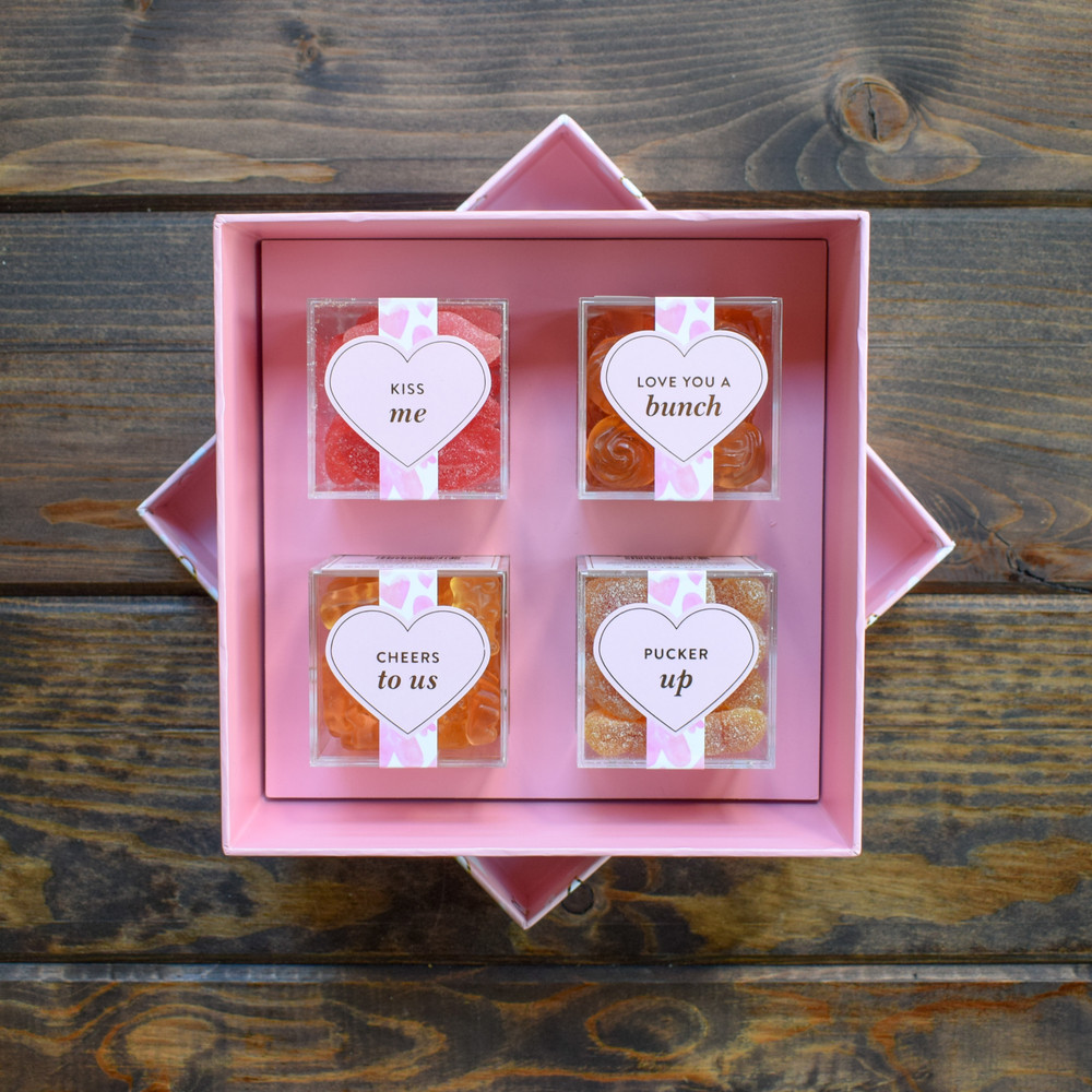 """Say just the right thing with these playful & sweet XOXO decorated gift boxes. The XOXO 4pc Candy Bento Box® includes 4 candy cubes® (approx 3.5oz each) with sweet sayings and best-selling Sugarfina candy. This giftset includes """"Kiss Me"""" Sugar Lips, """"Love You A Bunch"""" Rosé Roses made with Whispering Angel Rosé wine, """"Cheers To Us"""" Champagne Bears® made with Dom Pèrignon, and """"Pucker Up"""" Peach Bellini made with juicy peach nectar and sweet and sour sugar crystals."""