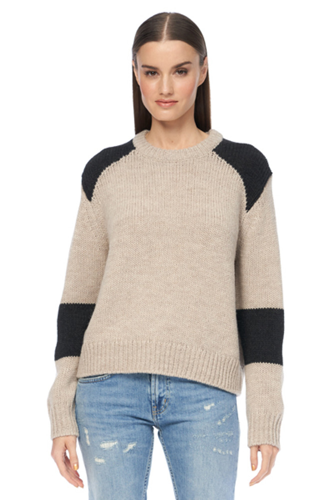 Street chic, this color block sweater pairs perfectly with any denim. Dress it up with heels or dress it down with boots, this ultra soft piece will become part of your weekly rotation.   Details:  30% Alpaca | 35% Merino | 35% Acrylic
