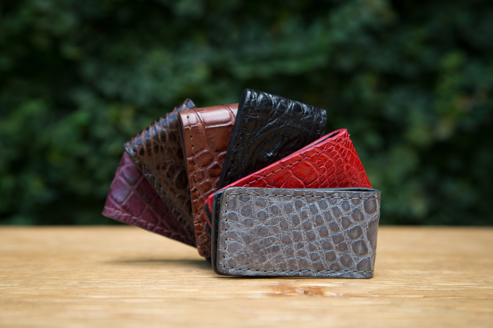 This luxe glazed alligator money clip is designed with a rectangular shape and hinged back to securely hold folded banknotes and cards. A practical luxury and excellent gift item. Available in a variety of colors, don't see your favorite color? Let us know and we can customize!