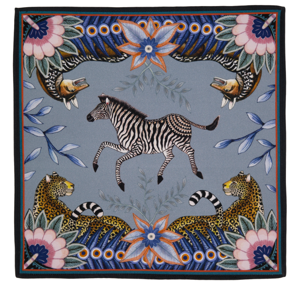 Bush Bandits - Frost  The perfect accent to any place setting! The ardmore napkins feature vibrant and whimsical depictions of the natural life in South Africa.