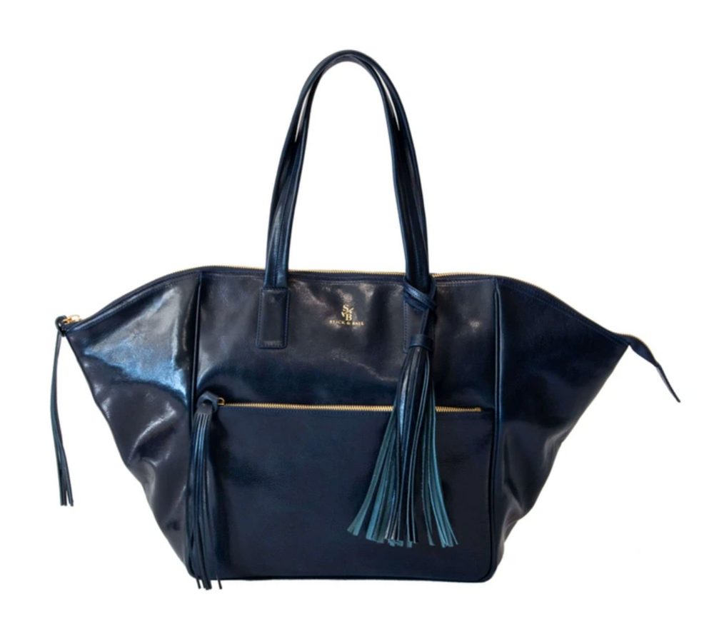 From everyday to travel essential this oversized tote is the perfect accessory. The luxurious Italian leather will just get more beautiful with time and the roomy nature can hold all of your everyday essentials as well as the extras when you travel!