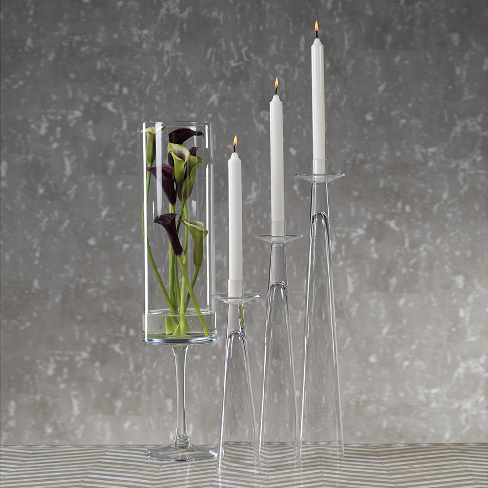 The Amin Glass Candleholders are the perfect thing to elevate your table setting! Ranging in heights they work well grouped together and the clear glass does not obstruct the person across from you!