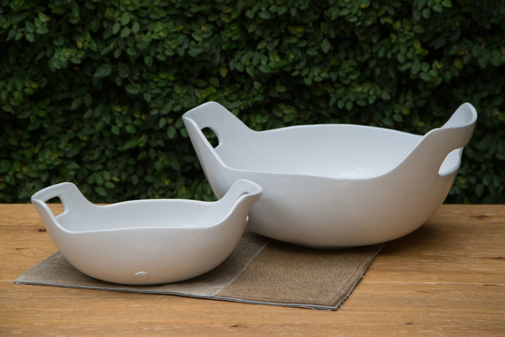 These bowls have a classic feel with a modern twist, the unique organic nature gives an unexpected texture while the clean line and bright white keep it modern. An entertaining bowl you'll want to use everyday!