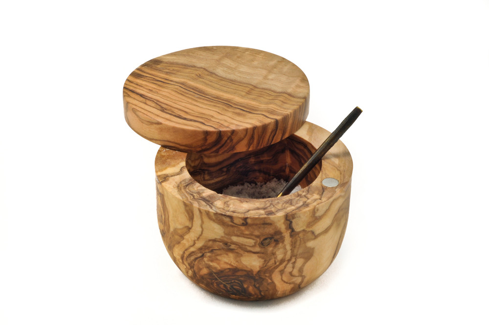 Keep your favorite herbs and spics at the tip of your fingers! This Olive Wood Salt Keeper allows you to keep you favorite seasonings on the counter, and the swivel top keeps them protected from danger! The magnetic closure helps avoid spills and makes closing a breeze!