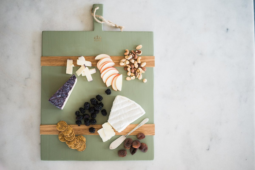 A modern twist on the classic European serving boards. The Rectangular Mod Charcuterie Board adds a splash of color to elevate your cheese boards, it's also great to use as a decorative piece in your kitchen or dining room!