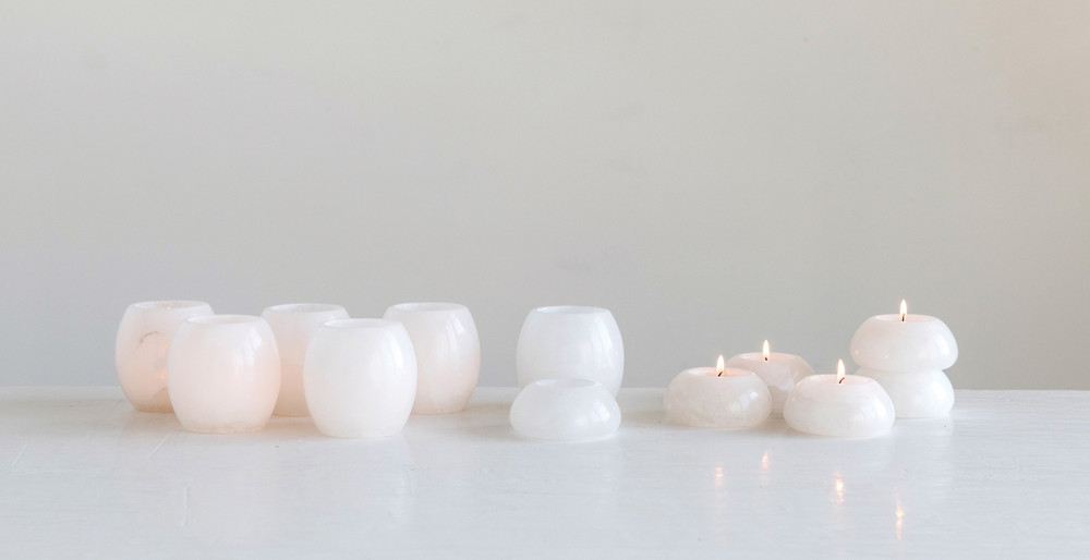 These smooth Alabaster Candle Holders will bring the perfect amount of warmth and light to any table! Beautiful paired together, or individually they will be your new favorite!